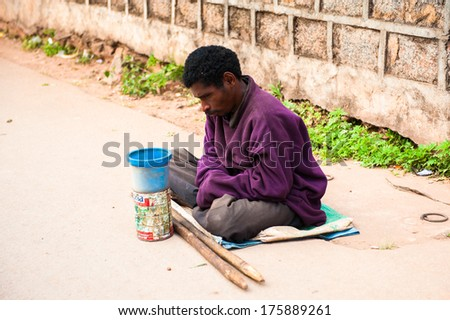 ANTANANARIVO, MADAGASCAR - JUNE 30, 2011: Unidentified Madagascar misery man in the street. People in Madagascar suffer of poverty due to the slow development of the country