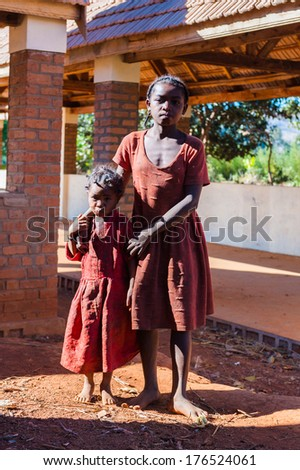 ANTANANARIVO, MADAGASCAR - JUNE 30, 2011: Unidentified Madagascar woman and her daught. People in Madagascar suffer of poverty due to slow development of the country