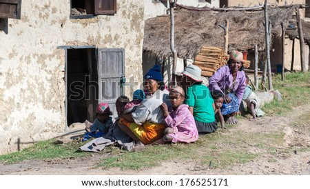ANTANANARIVO, MADAGASCAR - JUNE 30, 2011: Unidentified Madagascar woman plays with children.  People in Madagascar suffer of poverty due to slow development of the country