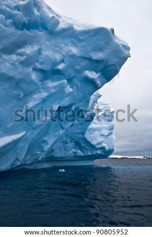Antarctic glacier in the snow. Beautiful winter background - stock photo