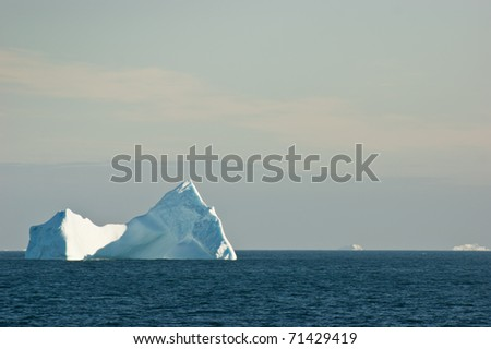Antarctic ice island  in atlantic ocean - stock photo