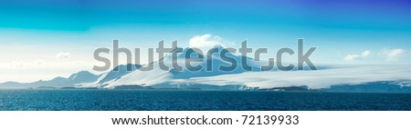 Antarctic ice island  in blue ocean. Orkney Islands. Summer season. - stock photo