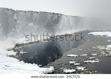 Antarctic ice shelf in mists - stock photo
