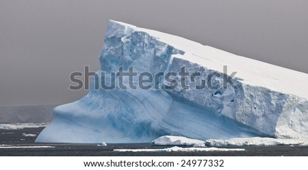 Antarctic iceberg - tilted - stock photo