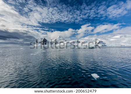 Antarctic peninsula covered in fresh snow - stock photo
