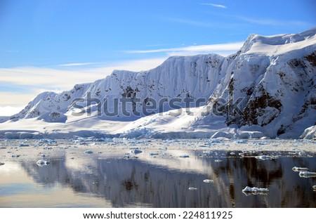antarctic peninsula in full sun - stock photo