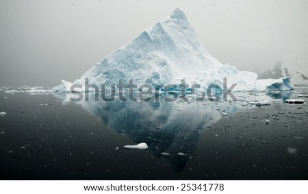 Antarctic triangular iceberg - stock photo