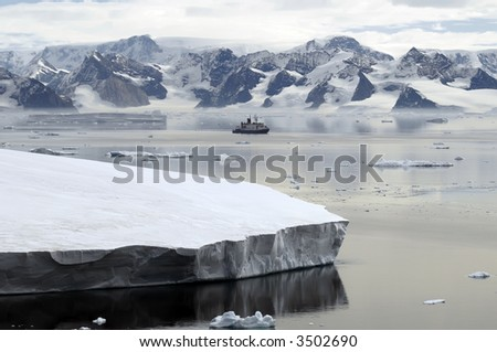 Antarctica and research vessel - stock photo