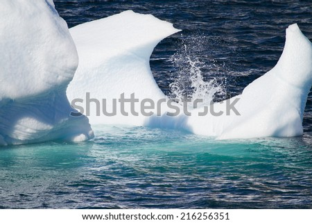 Antarctica - Antarctic Peninsula - Climate Change - Global Warming - Pieces Of Floating Ice And Waves Splashes / Antarctica - Floating Ice - Closeup - stock photo