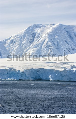Antarctica - Antarctic Peninsula - Palmer Archipelago - Neumayer Channel - Global warming - Fairytale landscape / Hills covered with snow in Antarctica - stock photo