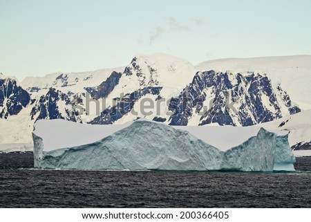 Antarctica - Coastline Of Antarctica With Ice Formations And Tabular Iceberg - Global Warming - Travel Destination / Antarctica - Tabular Iceberg  - stock photo