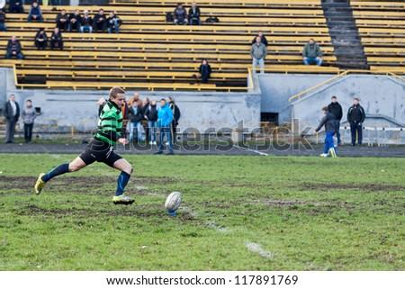 ANTARES - EGER, UKRAINE, KIEV-NOV. 4:Unidentified Anteres rugby player in action at a Ukrainian National Championship Final rugby match, Antares (green) vs. Eger (black), Nov. 4, 2012 in Kiev, Ukraine - stock photo