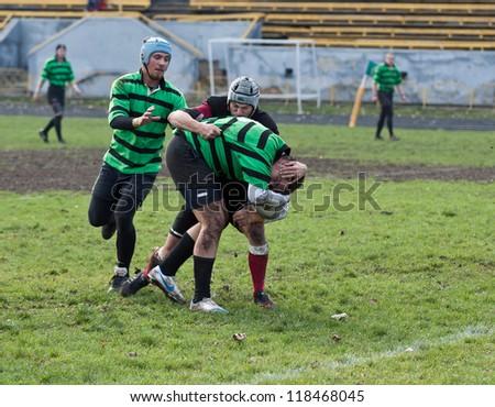 ANTARES - EGER, UKRAINE, KIEV-NOV. 4:Unidentified Eger rugby player in action at a Ukrainian National Championship Final rugby match, Antares (green) vs. Eger (black), Nov. 4, 2012 in Kiev, Ukraine - stock photo