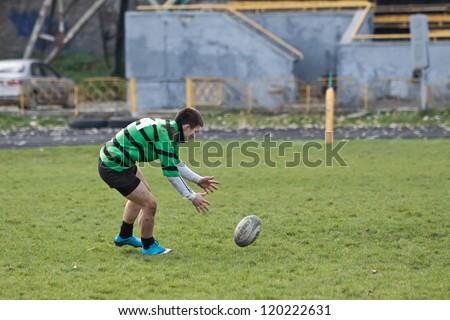 ANTARES - EGER, UKRAINE, KIEV- NOVEMBER 4 : Rugby player in action at a Ukrainian National Championship Final rugby match, Antares(in green) vs. Eger(in black), November 4, 2012 in Kiev, Ukraine. - stock photo