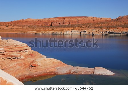 Antelope Canyon in the Navajo Reservation. The stone desert of red sandstone and bright blue waters. - stock photo