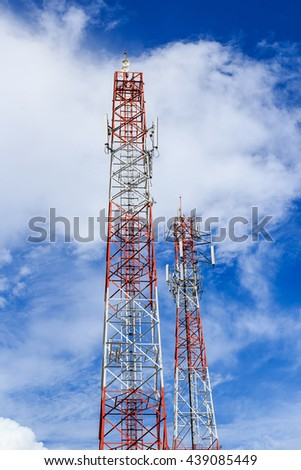 Antenna and cellular tower in blue sky background - stock photo