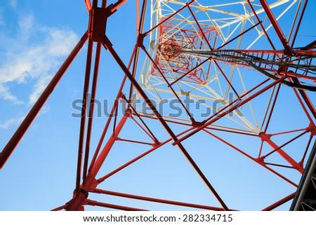Antenna broadcast TV signal on cloud sky background - stock photo