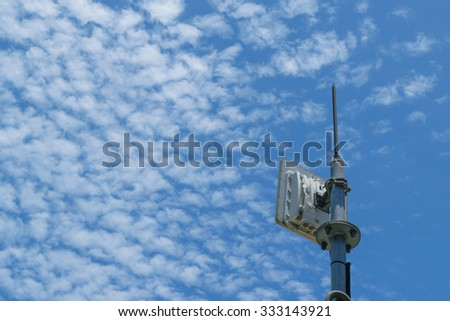 Antenna cellular tower and blue sky - stock photo