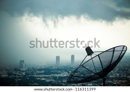 Antenna communication satellite dish with storm background - stock photo