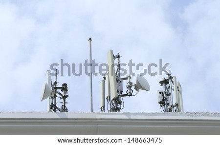 Antenna equipment on the top of the building - stock photo