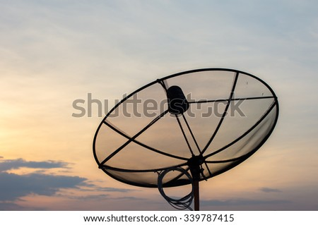 Antenna in front of sunset  - stock photo