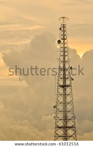 Antenna in the clouds - stock photo