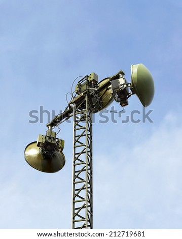 Antenna of the military communication radio link line on the mast - stock photo