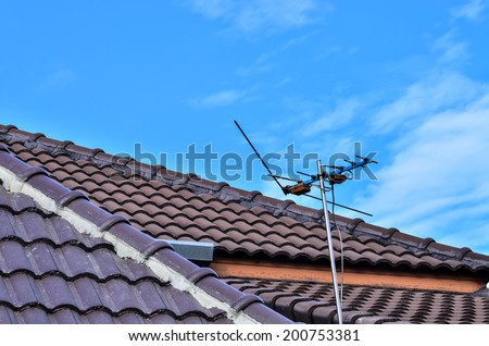 Antenna on the roof - stock photo