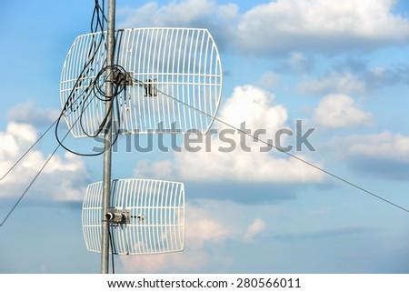 Antenna on the sky - stock photo