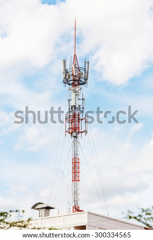 Antenna repeater tower on blue sky and white cloud, telecommunication concept - stock photo