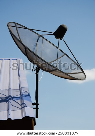 antenna satellite dish on the top of roof - stock photo