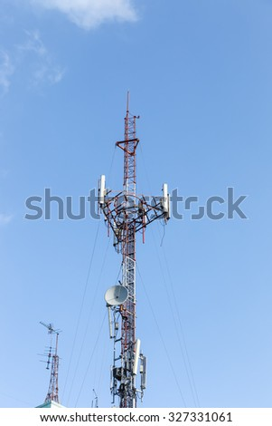 Antenna transmission tower with clear blue sky. - stock photo