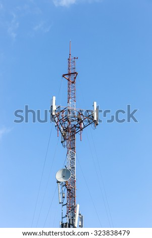 Antenna transmission tower with clear blue sky. Soft focus - stock photo