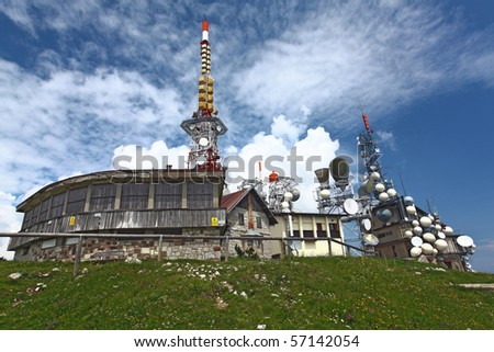 antenna tv station on mountain paganella trentino italian alps - stock photo