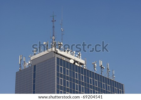 Antennas on the roof of the building - stock photo
