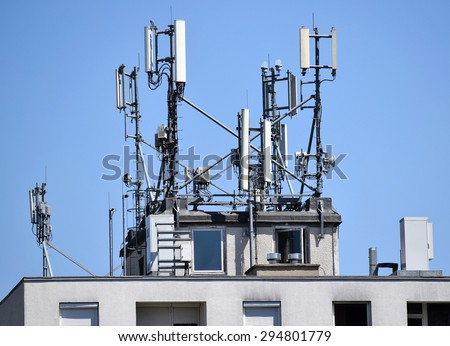 Antennas on the top of a building - stock photo