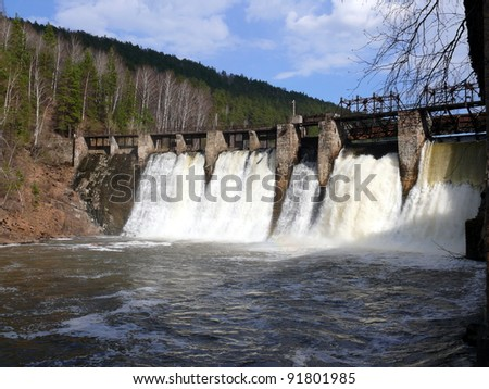 anthropogenic waterfall in satka river - village Porogi, Satka, Ural, Russia - stock photo