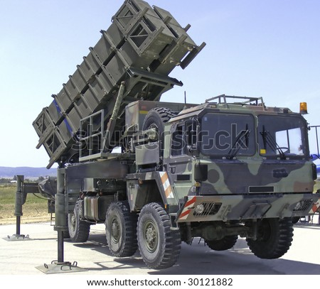 Anti aircraft missiles and truck - stock photo