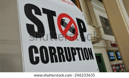Anti Corruption Sign in a Train Station in Thailand - stock photo