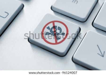 Anti piracy key on the keyboard. Toned Image. - stock photo