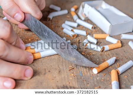 Anti-smoking conceptual background. Sliced cigarettes on the table. Giving up smoking