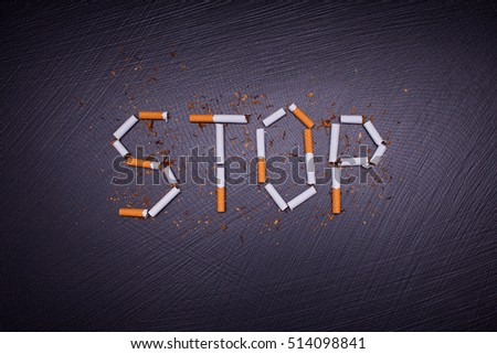 anti smoking poster on dark stone background