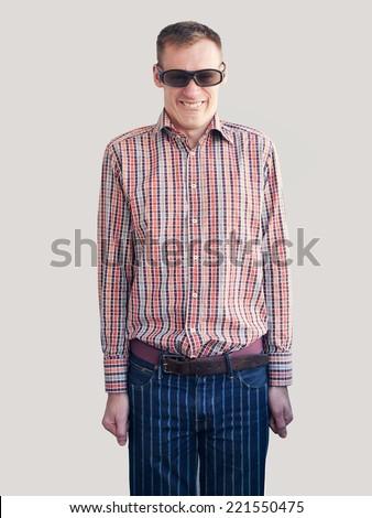 anti-style nerd man in plaid shirt, striped pants - stock photo