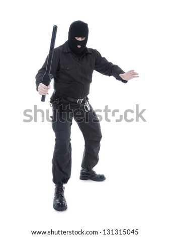 Anti-terrorist police guy wearing black uniform and black mask holding firmly police club in one hand ready for action, shot on white - stock photo
