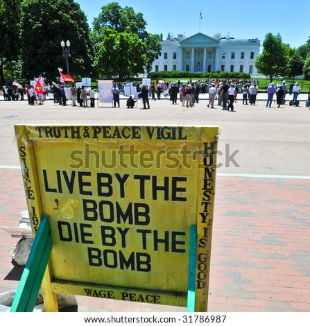Anti-War sign outside the White House North Lawn in Washington, DC. GPS coordinates embedded in metadata.