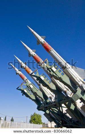 Antiaircraft rockets on the launcher against blue sky.