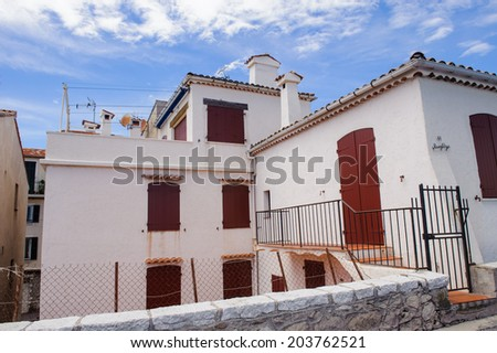 ANTIBES, FRANCE - JUN 25, 2014: Architecture of the Old Town of Antibes, Cote d'Azur, France. Antibes was founded as a 5th-century BC Greek colony and was called Antipolis
