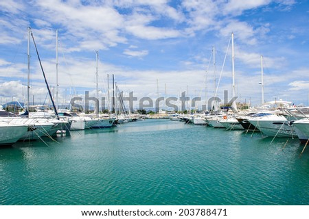 ANTIBES, FRANCE - JUN 25, 2014: Expensive achts in the Port of Antibes, Cote d'Azur, France. Antibes was founded as a 5th-century BC Greek colony and was called Antipolis