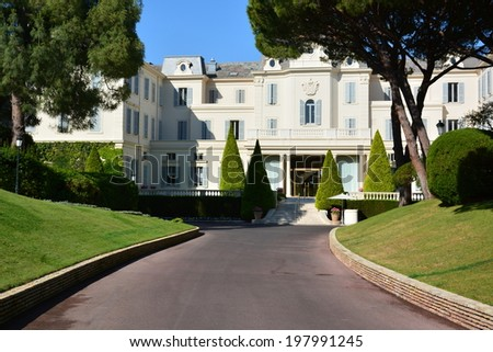 ANTIBES, FRANCE-JUNE 11: Eden Roc Hotel shown on june 11, 2014 in Antibes, France. This 5-star hotel of 117 suites welcomes numerous celebrities and organizes the most parties of Cannes film festival. - stock photo