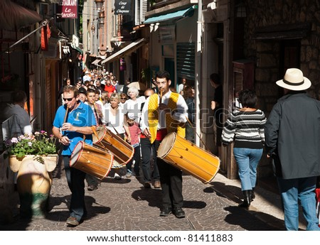 ANTIBES, FRANCE- MAY 1: Drummers lead parade through streets of Antibes on International Workers Day May 1, 2011. Also known a May Day, this holiday recalls left-wing, socialist labor day since 1886.